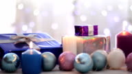 Christmas presents, balls and candles, Blurred bokeh background, dolly shot video