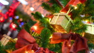 Christmas scene with tree gifts and lights in background video