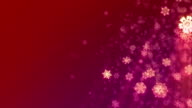 Christmas snowflakes falling on red background, loopable. HD, NTSC video