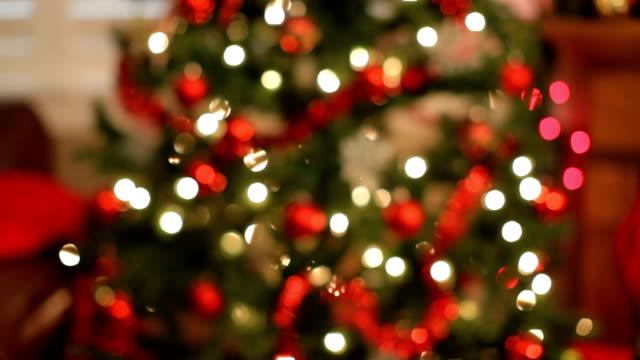 Christmas tree and gift, Rack focus video