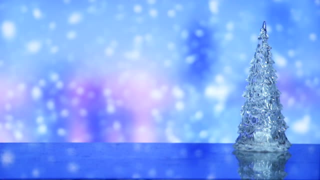 christmas tree and snowfall on background seamless loop video