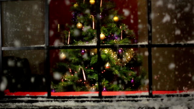 Christmas Tree at window with snow falling video