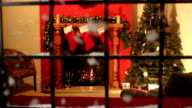 Christmas Tree, fireplace scene through window, Snow falling - Dolly video