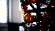 Christmas tree in garland with a toy video