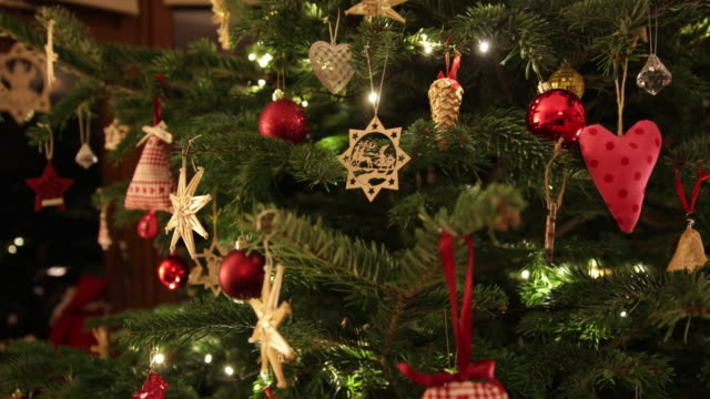 Christmas tree with hand made decorations panning video