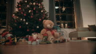 Christmas tree with presents in front of it video