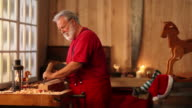 Christmas Video of Santa Claus Making a Toy in Workshop video