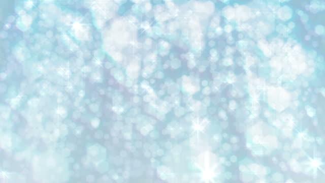 Christmas, wedding, celebration background loop: Defocussed snow or glitter, white. video