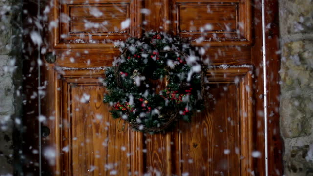 Christmas Wreath on door, Snowing video