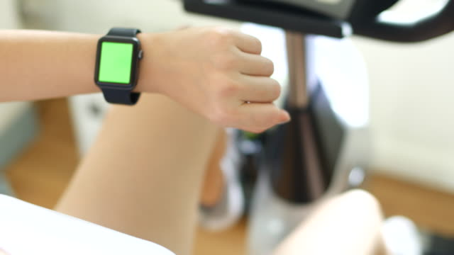 Chroma key,Woman wearing smart watch exercise video