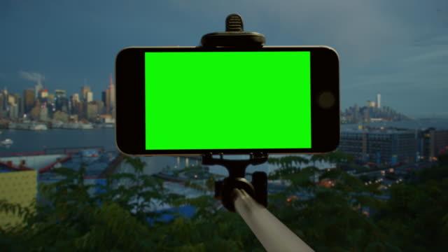 Chromakey green screen New York City selfie stick Smart phone video