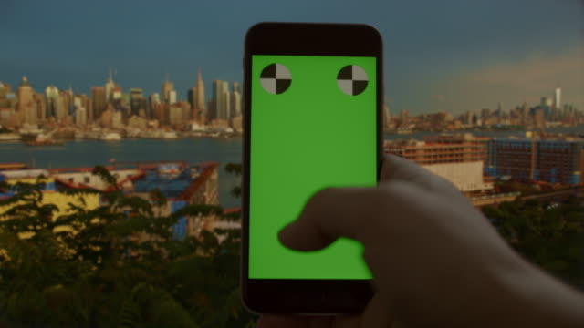 Chromakey green screen smart phone texting surfing New York City video