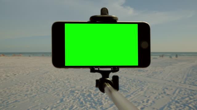 Chromakey green screen smartphone selfie stick Florida beach people video