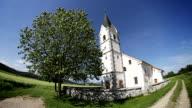 Church on a green field video
