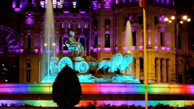 Cibeles fountain and city hall of Madrid iluminated in rainbow colors,Timelapse video