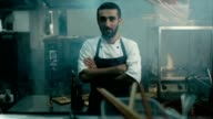 Cinemagraph - Handsome Caucasian chef standing in the restaurant kitchen video