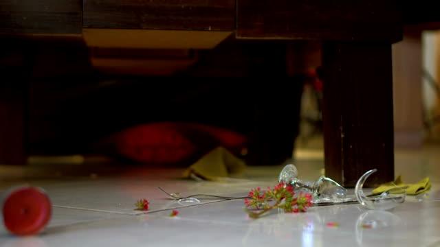 Cinemagraph of broken wine glass spinning on the floor video