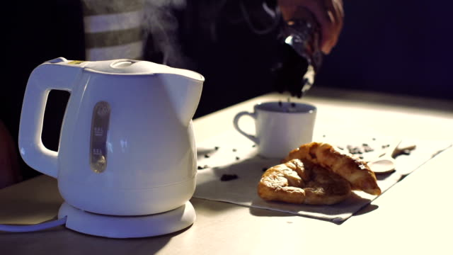 Cinemagraphs : Young barista preparing coffee with kettle. video