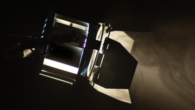 Cinematic fresnel lamp lights up from dark to bright light. video