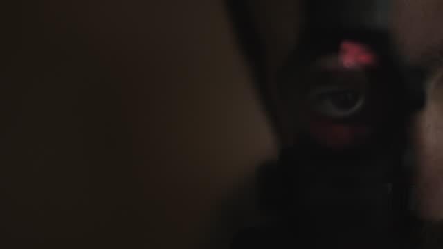 Cinematic Man Looks Through Gun Scope video