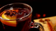 Cinnamon sticks falling from above in a nice mug of mulled wine video