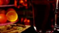 Cinnamon sticks falls into a beautiful mug of mulled wine video
