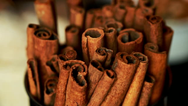 Cinnamon sticks slowly rotating video