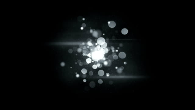 Circle blurred lights in center on black seamless loop animation video