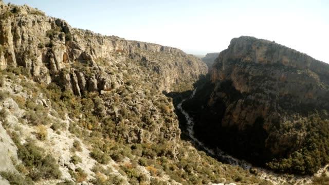 Circular panorama Gorge Seytanderesi The Man Rocks figures in niches Adamkayalar Mersin province Turkey video