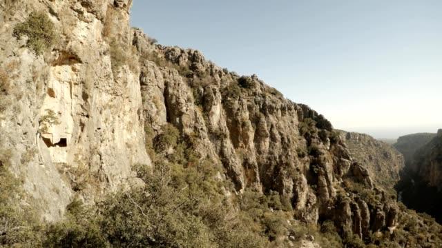 Circular panorama Rocks with caves Gorge Seytanderesi sunny day Adamkayalar Mersin province Turkey video