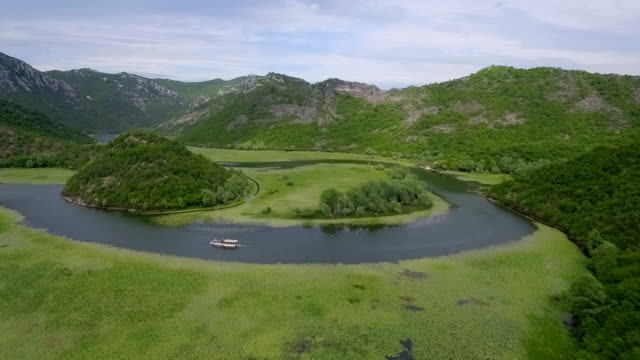 Circular watercourse turn with green lilies on water surface. video