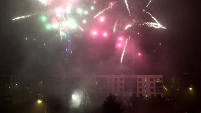 Citizen people celebrate new year in flat house yard and lot of fireworks blow video