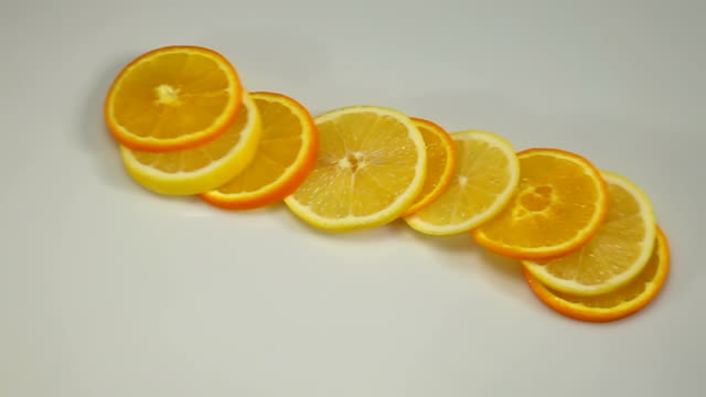 Citrus Fruit Slices Falling on the White Surface. video