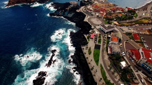 city and pools of Porto Moniz aerial view video