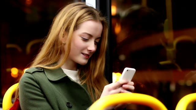 City bus at night, smartphone woman. video