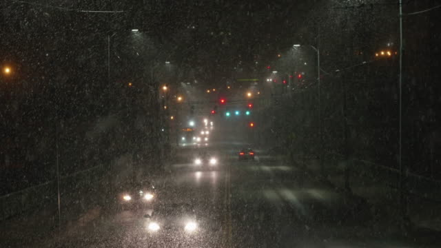 City Commuter Cars Driving in Dangerous Bad Weather at Night with Heavy Snowfall video