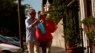 City couple window shopping on sunny day video