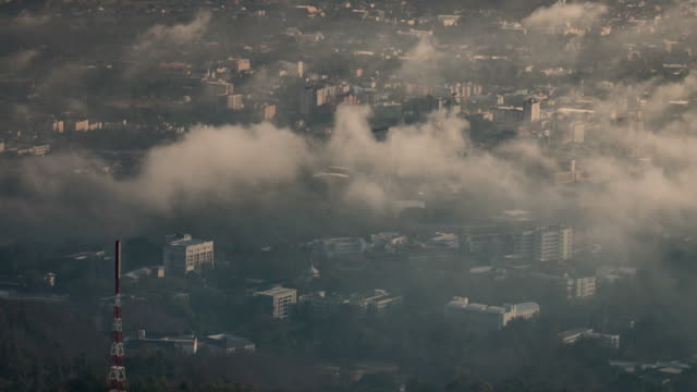 City in the mist and movement of cloud , time-lapse , 4k(UHD) video