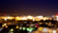 City lights blur at night. London video