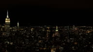 AERIAL: City lights in Midtown Manhattan looking towards Brooklyn at night video