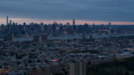 AERIAL: City lights lit up in New Jersey and New York City skyline at dark video
