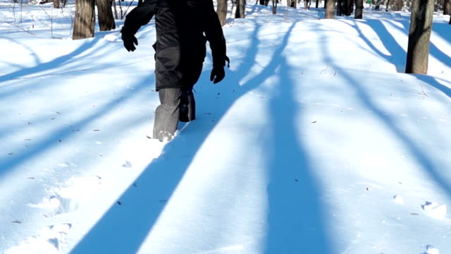 City Man Walking in Deep Snow on a Sunny Day video