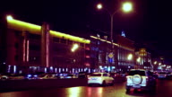 City road with cars and street lights at night video
