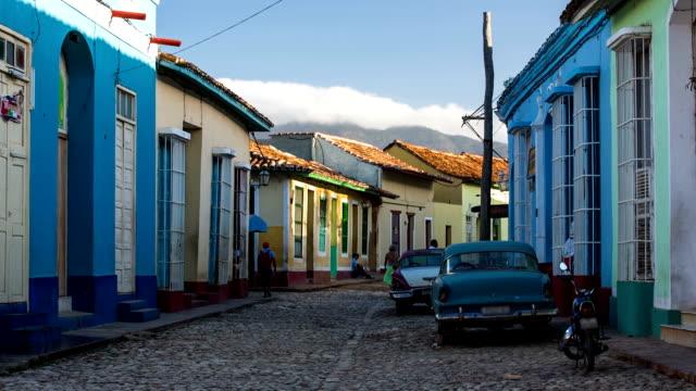 City street in Trinidad Cuba with vintage american car. video