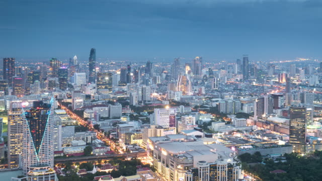 City Time Lapse day to night twilight time , cityscape of Downtown landmark Bangkok Thailand , UHD Format video
