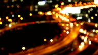 city traffic at night. Car headlights and tail lights out of focus video