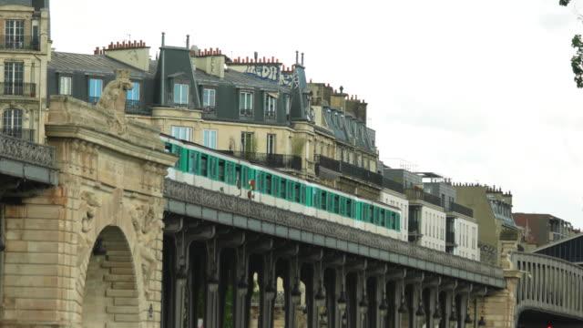City train moves near building. video