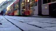 City tram carrying passengers along central street, public transport service video