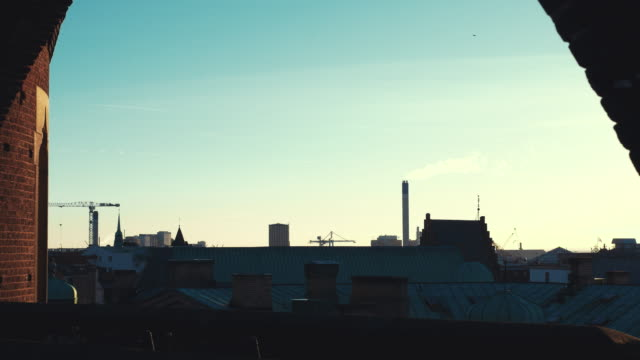 City view with buildings and smoke stack in Helsingborg, Sweden at dusk video