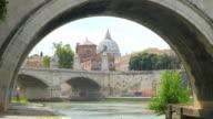 city view with stone birdge, tiber river, rome, italy, 4k video